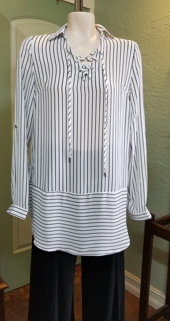 "Papa White Stripe Tunic at Bijou's Boutique.  Collar with front tie neckline.  Button cuff with option to    roll up and button.  Extra wide ""hemline"" with horizontal stripes and side slits.  95% Polyester/5% Spandex.  Made in Canada."