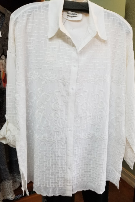 Paparazzi White Tunic Blouse at Bijou's Boutique. White on White multi-pattern embroidery.   Button cuff with optional roll-up and button sleeve. Small side slits. 100% Viscose.