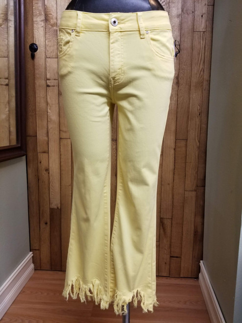 Charlie B Yellow Frayed Hem Jeans at Bijou's Boutique.   A curved, frayed hemline in lemon yellow color.  Cotton/Spandex blend.