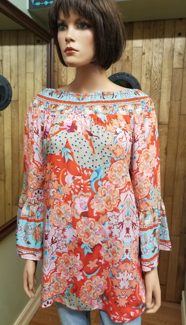A & A Red Floral Tunic at Bijou's Boutique. Smocked neckline that can also be worn off the shoulder.   Long petal sleeves. 100% Viscose.