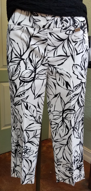 Michael Tyler White with Black Pattern Crop Pant at Bijou's Boutique.  Fun black leafy vine print.  Side    pockets.  Wide waistband.  Tummy minimizer with built in tummy control!    76% Viscose/20% Nylon/4% Elastane.  Made in Canada.
