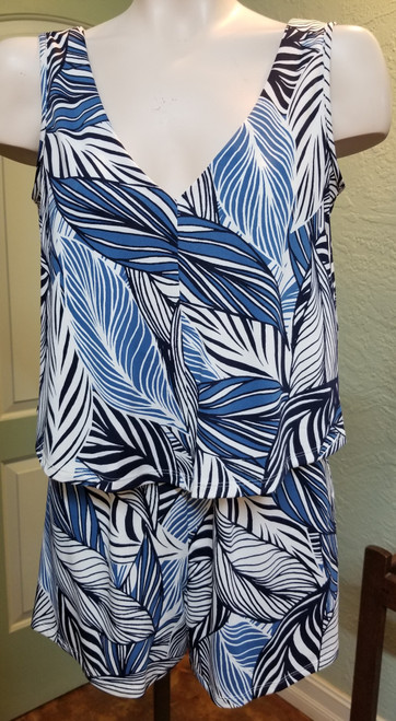Devia Romper at Bijou's Boutique.  Leaf print in multiple shades of blue.  Sleeveless V-neckline in both   front and back.  Fun and Flirty for your summer wardrobe!  96% Polyester/4% Spandex.    Made in Canada.