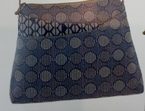 "Maruca Sparrow Handbag at Bijou's Boutique. Small daytime handbag measures   7.5""h x 9.5""l x 1.75""w with a 24"" strap drop. Strap is faux suede cord."