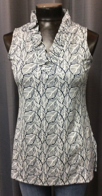 La Mer Luxe Sleeveless Top at Bijou's Boutique. Navy and White leaf design print. V-neckline with ruffle.   Side slits. Soft and light for the summer. 90% Polyester/10% Spandex.