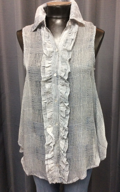 Papa Sheer Voile Blouse at Bijou's Boutique.  Dark Navy and White sleeveless, ruffle front button down  blouse. Hemline is longer in the front. Soft and light.  A Sexy top!!  Wear your prettiest bra or cami under it!!   A great jean shirt.  100% Rayon.