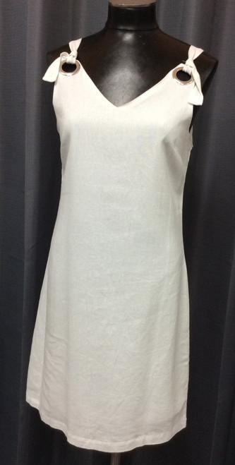 Charlie Paige White Linen Dress at Bijou's Boutique. Fully lined. Large silver rivets allow for   adjustable straps. 55% Linen/45% Viscose. Lining is a Poly/Cotton blend.