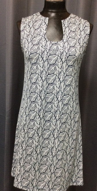 La Mer Luxe Leaf Print Dress at Bijou's Boutique. Navy and White print dress with unique neckline.   Cute and easy - Soft and light! Perfect for any occasion. Poly/Spandex blend.