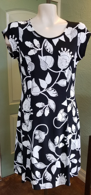 Devia Black & White Floral Leaf Print Dress at Bijou's Boutique.  Small cap sleeve.  Scoop neckline.     95% Polyester/5% Spandex.  Made in Canada.