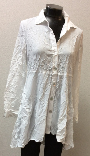 Liv by Habitat White Crinkle Button Shirt at Bijou's Boutique.  Collared shirt with full front   button down.  Could be worn open as a jacket.  Long sleeves.  Side pockets. Longer back  hemline.   Crinkle fabric makes it great for travel.  100% Polyester.