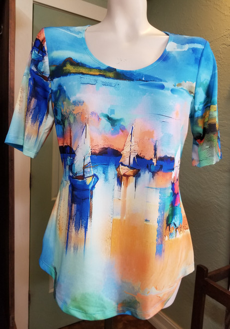 Artex Sailboat Print T-Shirt at Bijou's Boutique.  Short Sleeve with V-neck.  Bright colors   with a beautiful sailboat scene print.  95% Polyester/5% Spandex.  Made in Canada.     This print is also available in Artex Sailboat Print Tank Dress.