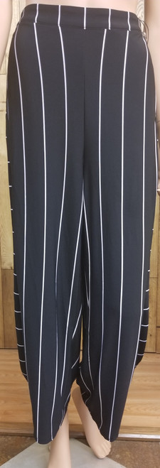 Liv by Habitat Clothing Black Pant with White Stripes at Bijou's Boutique.  Front seam  pockets.  Opposite stripe pattern down outside of legs.  Pinched gathering detail at  the ankle.  95% Polyester/5% Spandex.     Made to be worn with but sold separately from Liv by Habitat Black Tank.