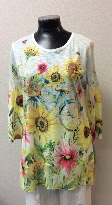 Jess and Jane Sunflower Tunic at Bijou's Boutique. Three-quarter length sleeve.   Chiffon trim at hemline. 92% Polyester/8% Spandex - feels like Cotton. Made in the USA.