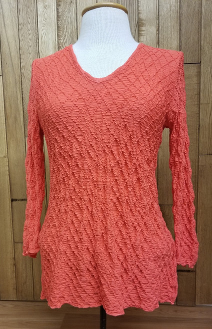 Sno Skins Tangerine Long Sleeve Top at Bijou's Boutique. V-Neck. Comfy, stretchy, easy to pack.   91% viscose, 5% nylon, 4% spandex. Made in the U.S.A.