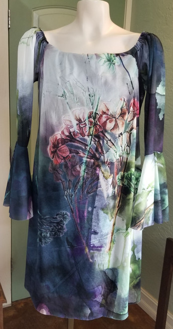 Elana Kattan Floral Dress at Bijou's Boutique. Optional off the shoulder, sheer petal sleeve dress. Fully lined with sheer   floral print overlay. 100% Polyester lining/ 100% Nylon. Made in the USA.