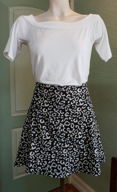 La Mer Luxe Black Safari Knit Martha Skort at Bijou's Boutique. Elastic waistband.   Small tier in lower skirt. 90% Polyester/10% Spandex.
