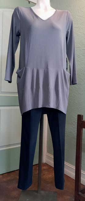 Liv by Habitat V-Neck Tunic in Musk at Bijou's Boutique. Long sleeves with outer   front pockets. Stitching detail on lower front of hi/low hemline. Size runs  generously. 95% Polyester/5% Spandex.