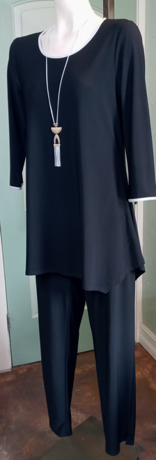 JJ Black Tunic with White Accents at Bijou's Boutique. Long sleeve. White piping   accent at the neckline, cuffs and back criss cross detail. 95% Polyester/5% Spandex.     Option to be worn with JJ White Zipper Vest - #31-0006
