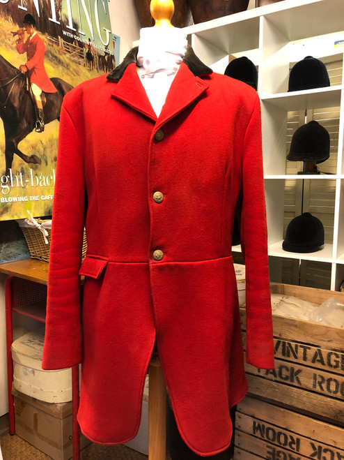 "Long cut red hunting frock coat, 44"" long. Caldene."