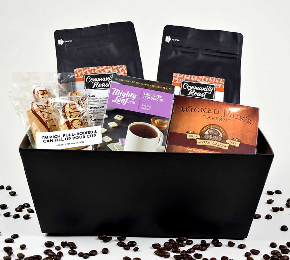 2# Community Roast Coffee, 1 box of Tea, 4 Almond Biscotti and 4 oz Butter Rum Cake. A few of Joe's exclusive stickers all packed in a black tray.