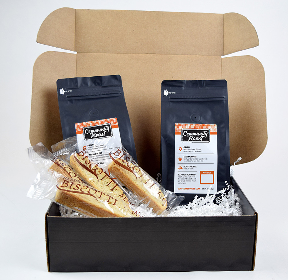2# Community Roast Coffee and 4 Almond Biscotti. A few of Joe's exclusive stickers all packed in a black box.