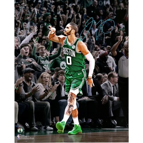 Jayson Tatum celebrating on a basketball court for the Boston Celtics