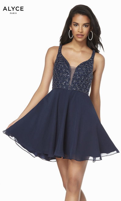 Intricate detailing by Alyce 1489 with embellished beaded bodice and strappy back. Flowy A-line skirt that is perfect for homecoming or formals shop prom-avenue  Available in Midnight Blue