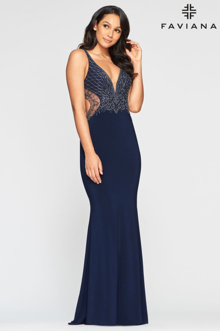 Unforgettable evenings start with Faviana Style S10470! Sleek stretch jersey cascades from a plunging neckline to a figure-flaunting maxi skirt. The bodice is dripping in beaded embroidery with a sultry open back and cutout sides.- shop prom-avenue  Available in Navy