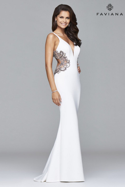 Faviana Style S7916 will surely make a statement. Ideal for an hourglass body shape, this dress features a V-neck with a slight plunge and side cutouts that are adorned with intricate beading and applique. This comfortable, neoprene style is available in ivory, navy, and seafoam. Pair with matching jewelry and shoes to highlight the artful beading. Feel glamorous at your wedding, prom, or a pageant.- shop prom-avenue