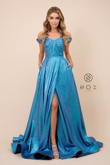 Show off your unique style in this comfortable off the shoulder formal dress with long ball gown silhouette and side slit that is ready to take the spotlight. This dress also features side pockets - shop prom avenue  Available in Metallic Blue, Metallic Purple