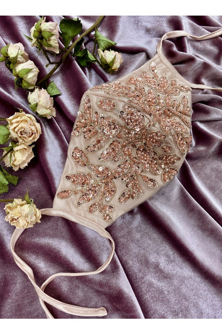 One size, available in Rose Gold  This beautiful hand beaded fashion mask has adjustable straps to tie behind your ears and individually packaged.   With polyester lining and soft satin finish.- sho prom avenue  This product is non medical and intended as a face covering in public settings when social distancing is difficult to maintain.   PLEASE NOTE: This  item cannot be returned and sale is final