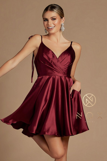 Classy and flirty little burgundy A-line homecoming dress with sleeveless pleated bodice and zipper closure. It features soft satin fabric that flows beautifully with each twirl in style NX R701  Available in Burgundy