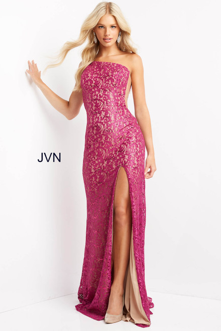 Stunning one shoulder long dress in style JVN 06127 with embellished fuchsia color lace over a nude lining. This dress has a shear illusion cut out side and one shoulder neckline. This dress has a side slit on fitted silhouette, perfect for you special occasion or prom - shop prom avenue  Available Fuchsia