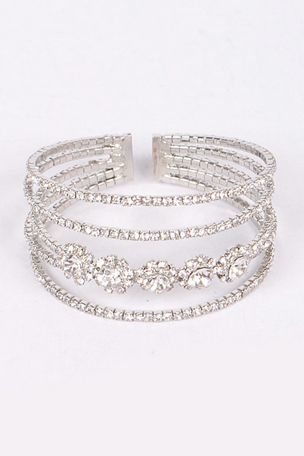 Sleek and exceptional elegance in an open cut silver plated bangle that is delicate, adorned with brilliant clear rhinestone and perfect for your wrist on any occasion- shop prom avenue