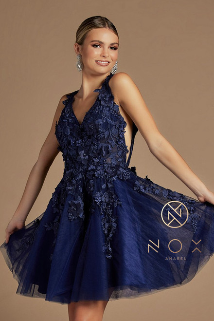 Beautiful short layered homecoming or sweet 16 with 3D floral lace throughout the bodice in V neckline in style NX R708. With tulle material and zip up closure. This dress will sure bring a memorable night- shop prom avenue  Available in Navy Blue and Rose