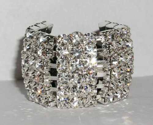"PLATED IN STERLING SILVER  IT IS  13/16 "" WIDE and 1 1/8"" HIGH.  RHINESTONE ELASTIC PONY TAIL HOLDER"