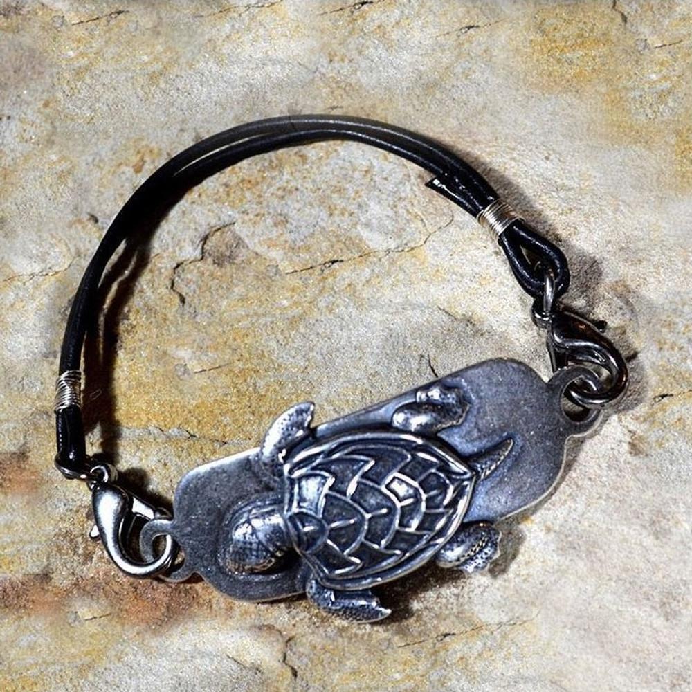 Sea Turtle Antiqued Silver Brass Rawhide Bracelet | Elaine Coyne Jewelry | ECGNAAS930rb-1
