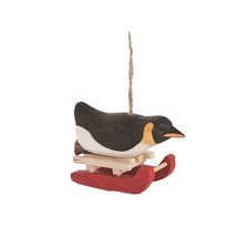 Carved wooden Penguin Sled Race Ornament | Gallerie II | ORN73827 - 2
