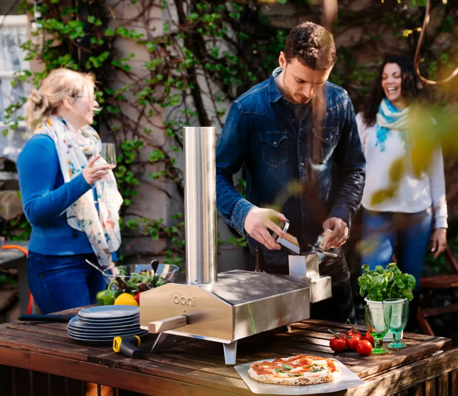 Man using ooni portable pizza oven oven