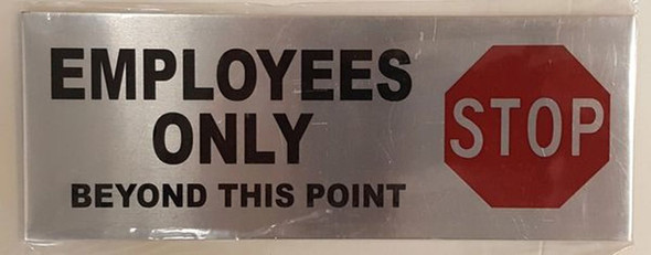 SIGNS EMPLOYEES ONLY BEYOND THIS POINT STOP