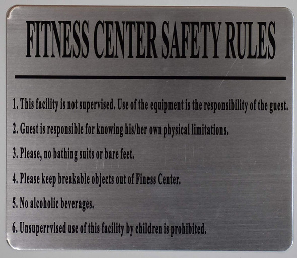 Sign FITNESS CENTER RULES - USE EQUIPMENT AT YOUR OWN RISK - CONSULT YOUR PHYSICIAN BEFORE BEGINNING ANY EXERCISE - USE THE EQUIPMENT ONLY FOR ITS INTENDED PURPOSE PLEASE WIPE OFF EQUIPMENT AFTER USE - APPROPRIATE FITNESS ATTIRE MUST BE WORN - DO NOT EXERCISE WHILE IMPAIRED BY ALCOHOL OR DRUGS - 20 MINUTE LIMIT PER STATION WHEN OTHERS ARE WAITING - NO EATING OR GLASS CONTAINERS IN FITNESS AREA - DO NOT DROP WEIGHT - RETURN OR REMOVE WEIGHT WHEN YOU ARE DONE - NO LOUD NOISES OR GRUNTING