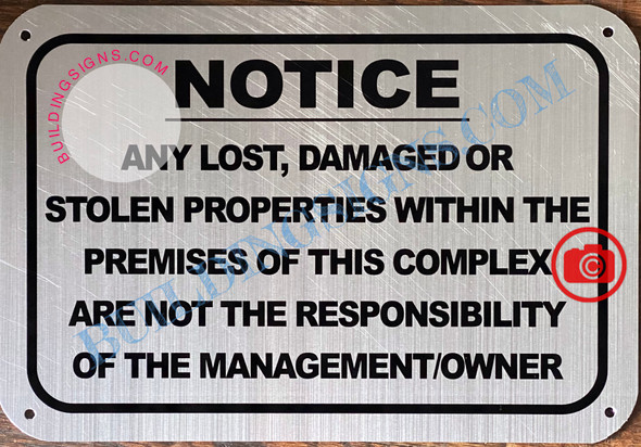 NOTICE ANY LOST DAMAGED OR STOLEN PROPERTIES WITHIN THE PREMISES OF THIS COMPLEX ARE NOT THE RESPONSIBILITY OF THE MANAGEMENT OR OWNER SIGN