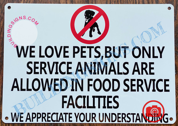WE LOVE PETS BUT ONLY SERVICE ANIMALS ARE ALLOWED IN FOOD SERVICE FACILITIES SIGN