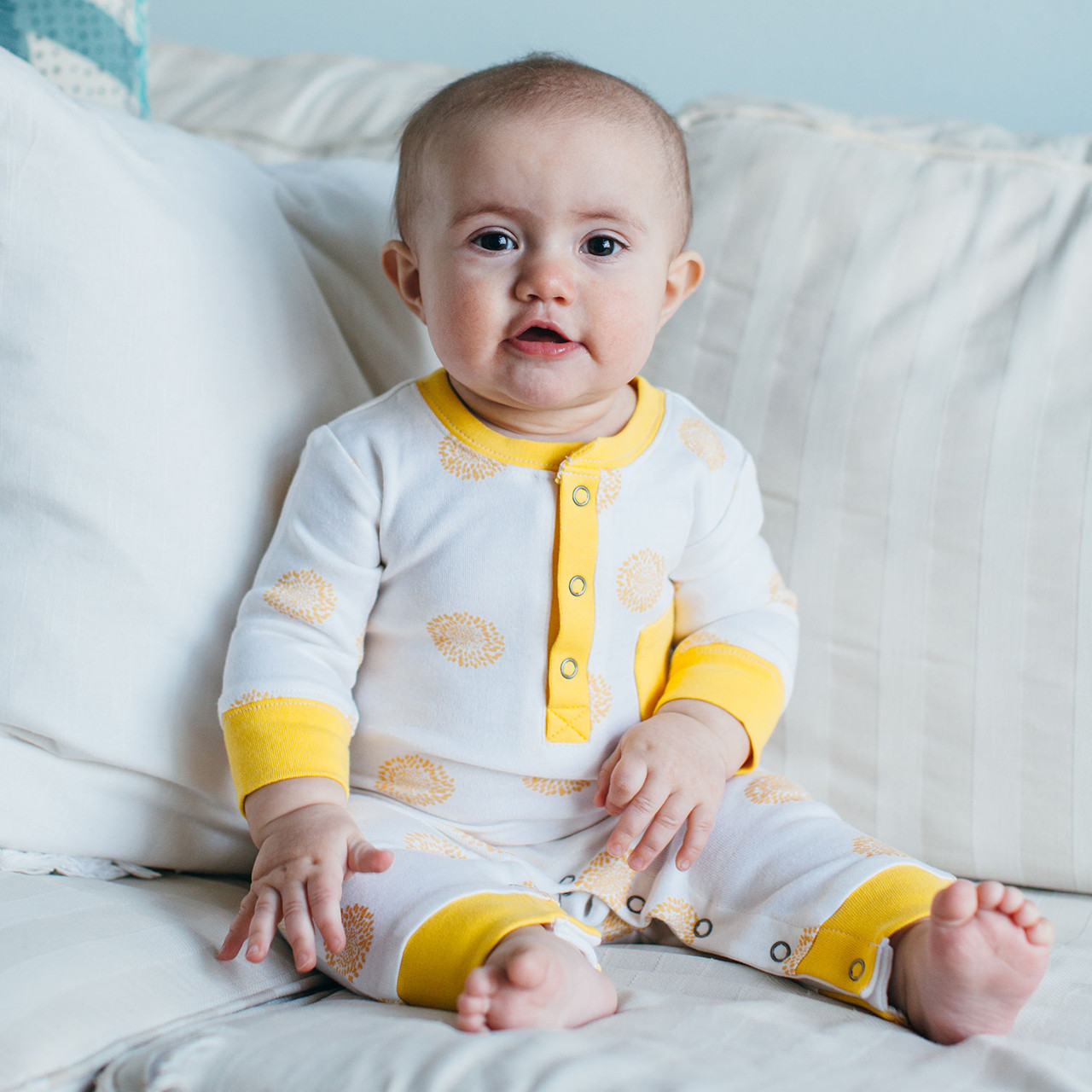 Organic Footless Romper in Yellow Sunflower, Lifestyle