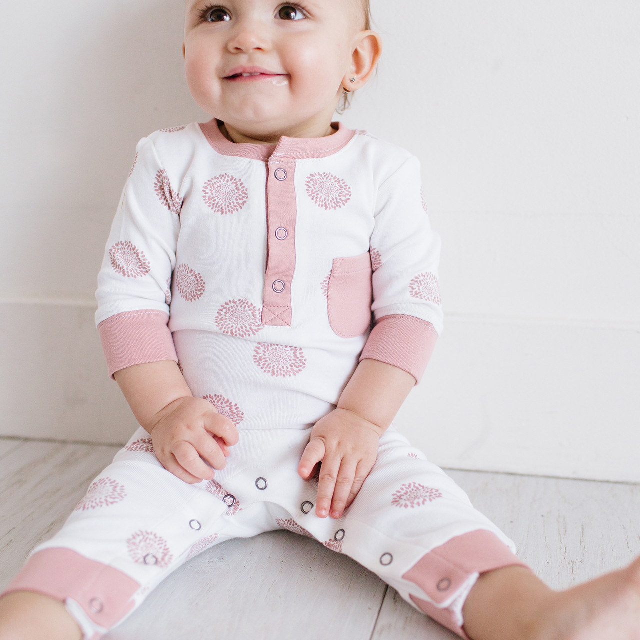Organic Footless Romper in Mauve Sunflower, Lifestyle