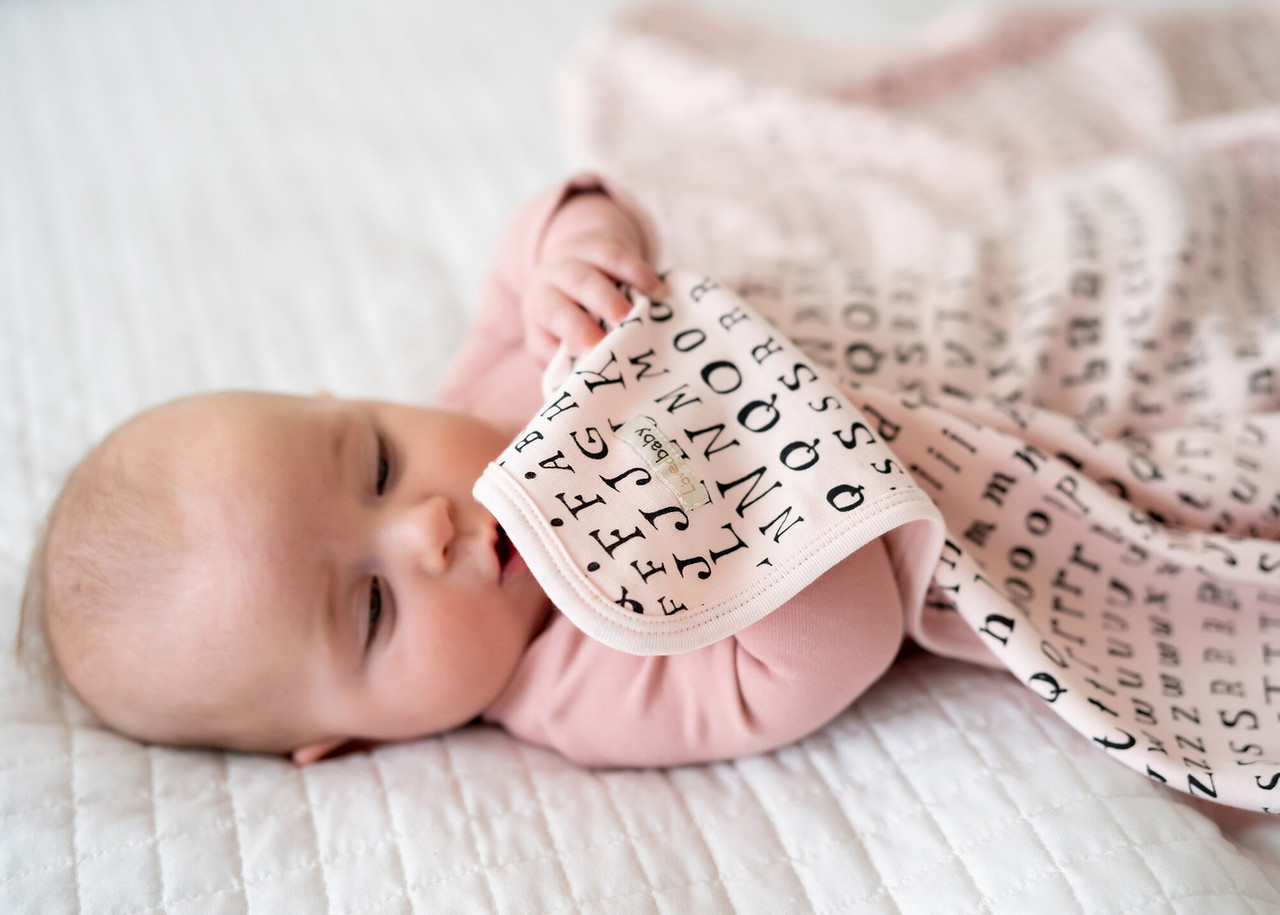 Organic Swaddling Blanket in Blush Letters, Lifestyle