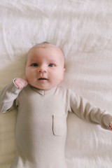 V-Neck Baby Footie in Light Gray Dots, Lifestyle