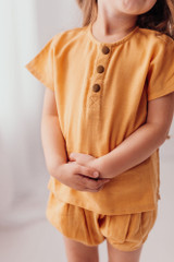 Organic Kids' Muslin Shorties in Apricot, Lifestyle