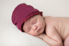 Organic Lace Ruffle Cap in Cranberry, Lifestyle