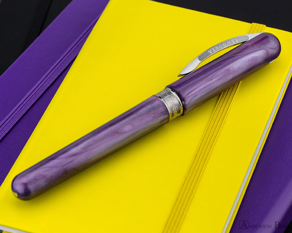 Visconti Breeze Fountain Pen - Plum on Notebook