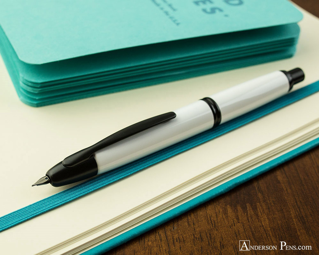Pilot Vanishing Point Fountain Pen - White with Matte Black Trim - Open on Notebook
